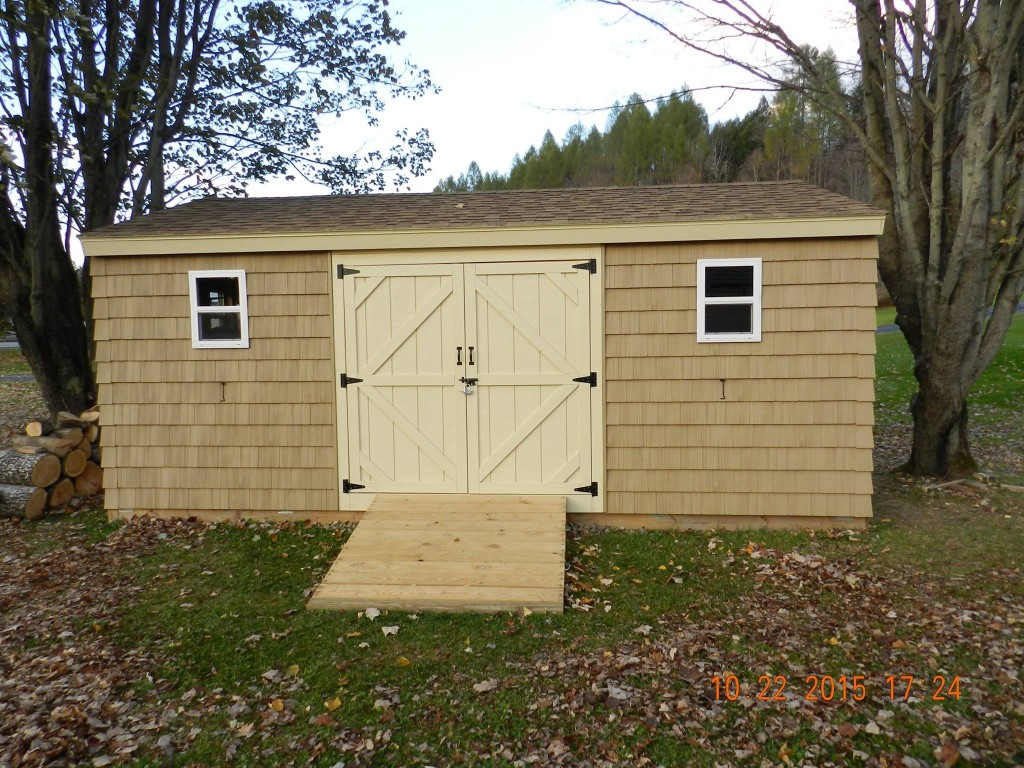 12x20 backyard shed with shake siding