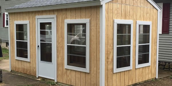 backyard shed with screened windows