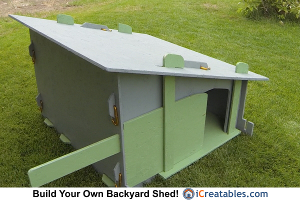 The door on the chicken coop is easily opened and closed while standing outside the chicken run.