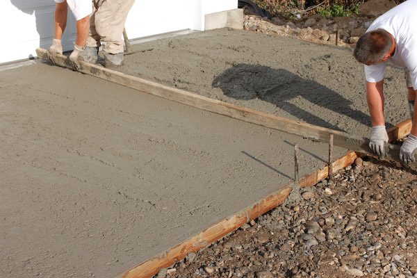 Lay concrete pour and finish concrete slab for storage sheds for How to finish a wood slab