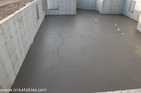 Pour basement concrete slab for new home for Building a house on a slab