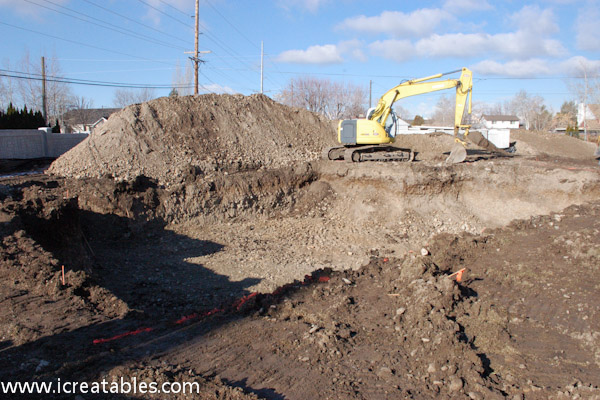 Excavate sewer and basement home for Digging foundation for house