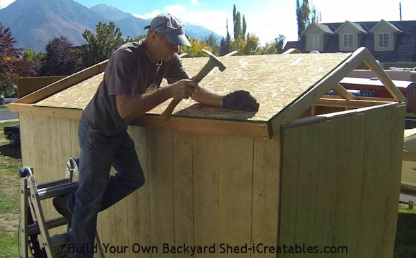 How to build a shed roof installing the first piece of roof sheeting