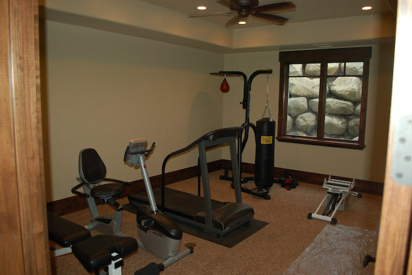 exercise room with wood trim