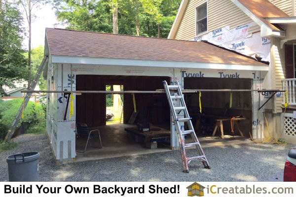 The garage with roofing and soffit and fascia installed. Ready for siding.