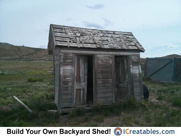 12x20 shed showing shake siding and optional single man door installed on end of shed.