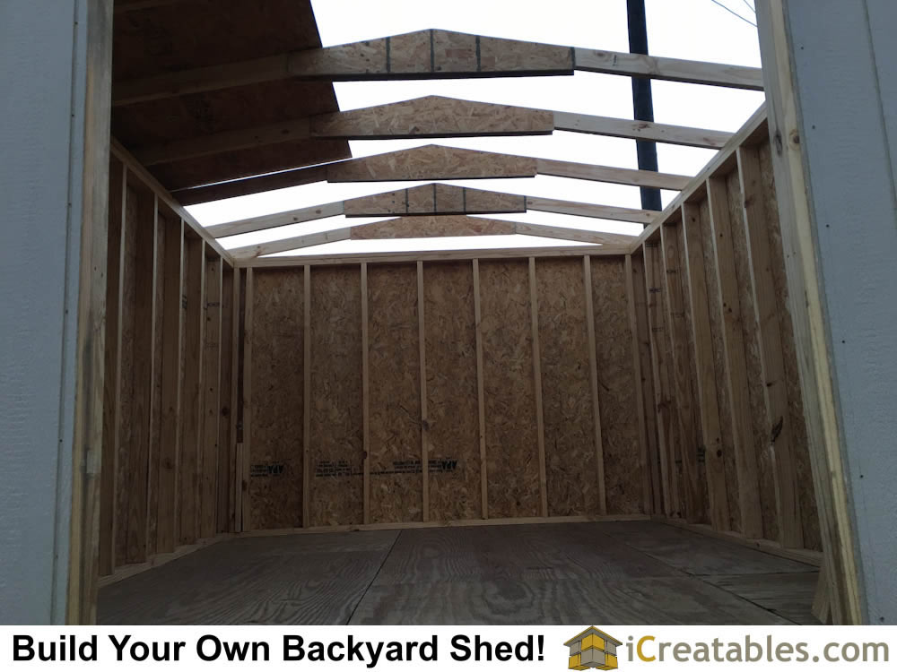 10x12 backyard shed with roof rafters installed. Notice larger gussets to allow larger span without a truss bottom chord.