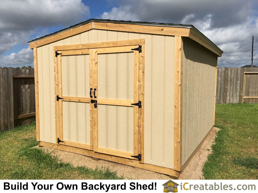 Home built shed doors installed on backyard shed.