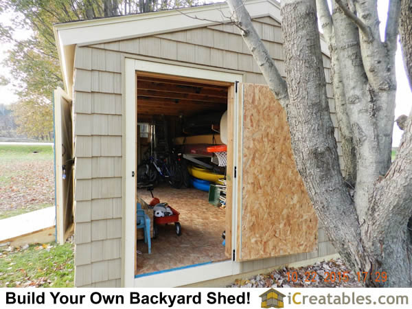 12x20 End door open showing massive amount of shed storage space.