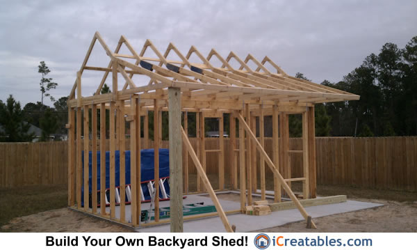 Roof rafters installed on shed with porch.