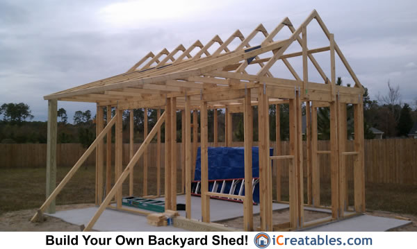 Shed with porch roof rafters installed. The beam under the porch overhang is not yet installed.
