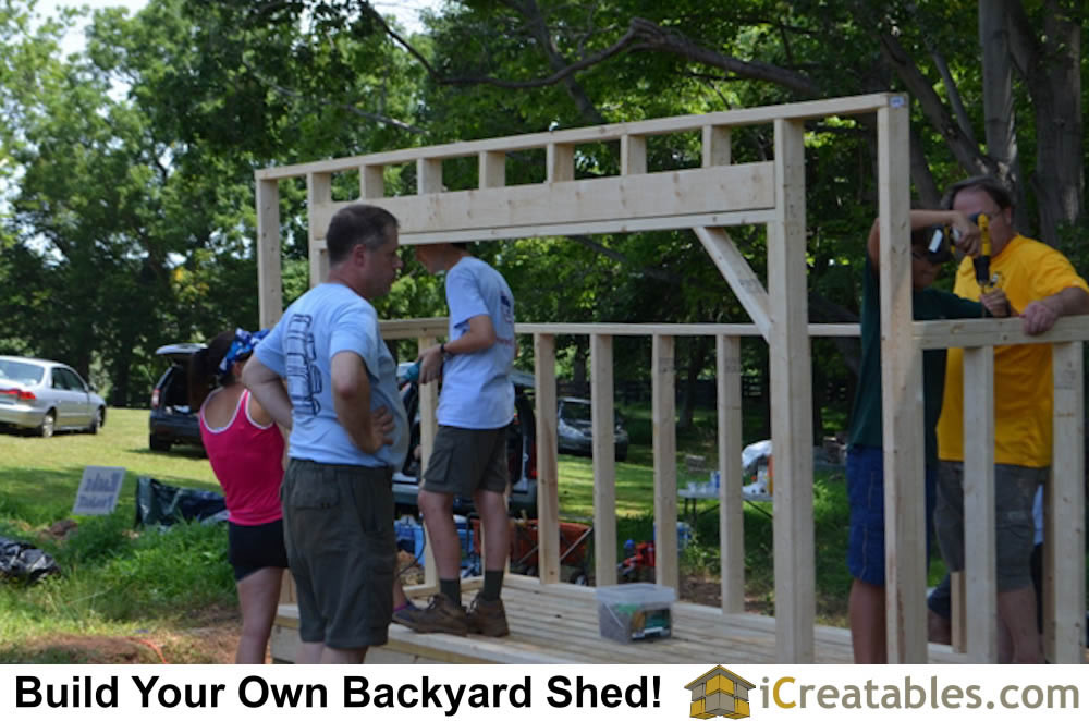 Framing the walls for the backyard shed plan. The large front opening allows easy access to seasoned firewood.