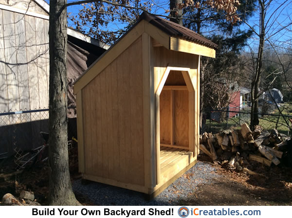 firewood shed siding installed