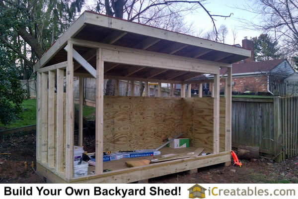 The 5x12 firewood shed roof is sheeted with plywood.