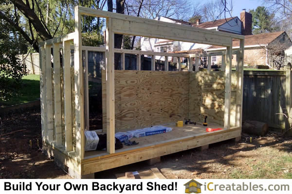 Interior wall sheeting is installed on the firewood shed.