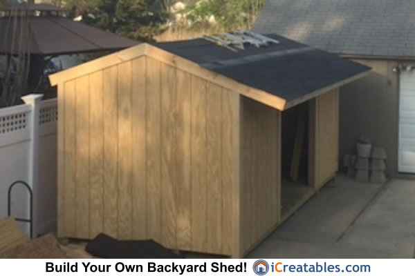 Firewood shed asphalt shingle install.