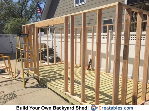 Firewood shed plans door header installed