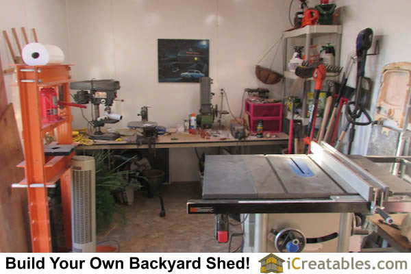 Shop workspace inside 10x20 gambrel small barn.