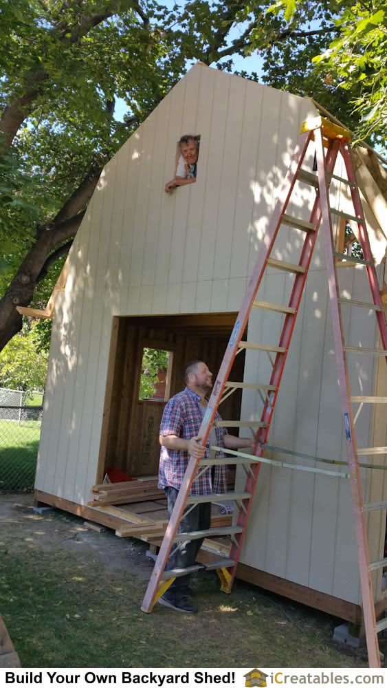 Installing siding on the shed gable ends is done after the roof is framed.
