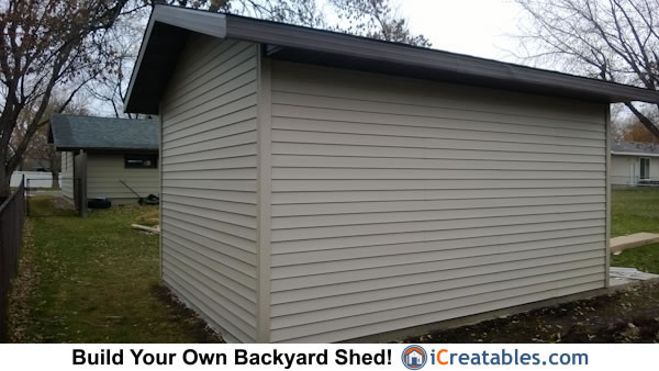 Shed with garage door. Backyard storage workshop