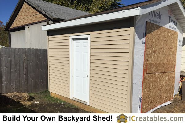 Installing vinyl siding on 12x16 backyard garage door shed