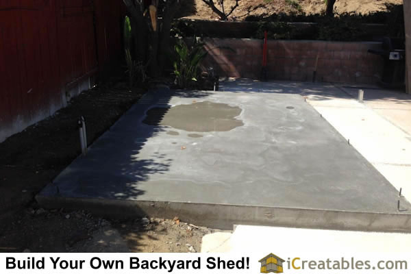Backyard shed concrete slab installed. The electrical conduit to the shed can be seen on the left.
