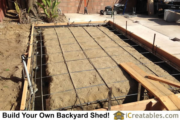 Backyard shed concrete monolithic slab and footing. Rebar installed. Shed electrical in footing.