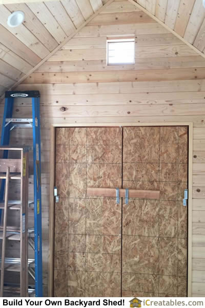 Shed door interiors. Check out the ceiling detail finish with the tongue and groove wood.