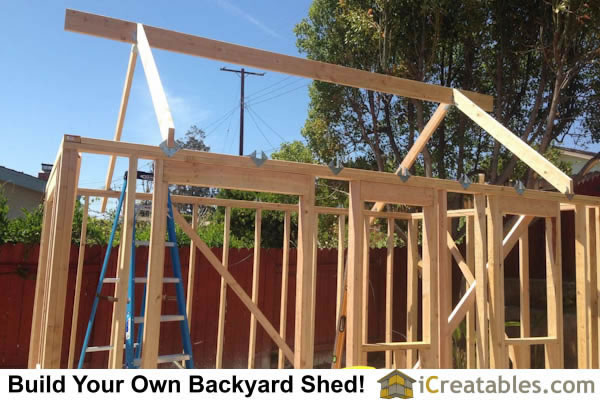 Garden shed roof framing. Install ridge beam on shed roof. Stick framing.