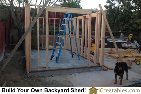10x16 Garden shed wall framing with door and window headers installed.