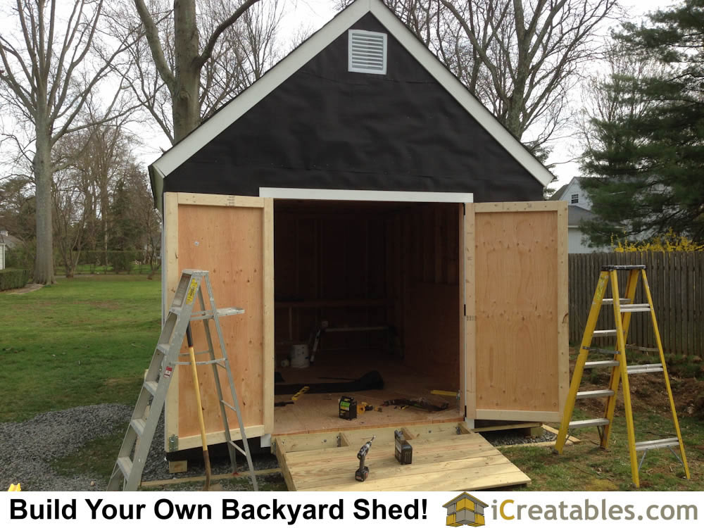 Installing the home built shed doors on the backyard storage shed.