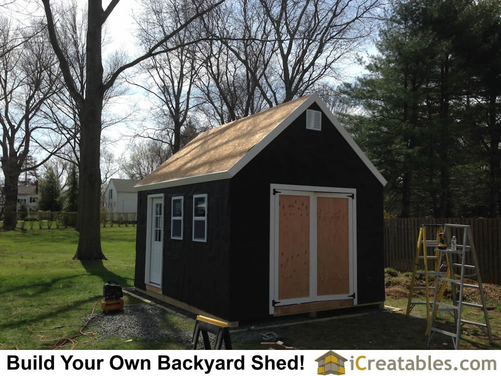 Shed with building paper and trim installed. It is now ready for roofing and vinyl siding.