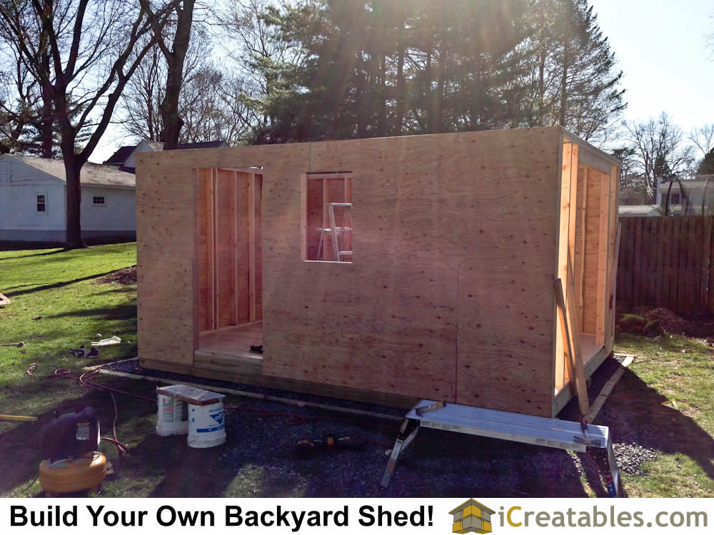 Shed walls framed. The shed window openings are cut out after the sheeting is installed.