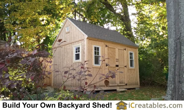 Completed 12x16 shed plans in a beautiful backyard.