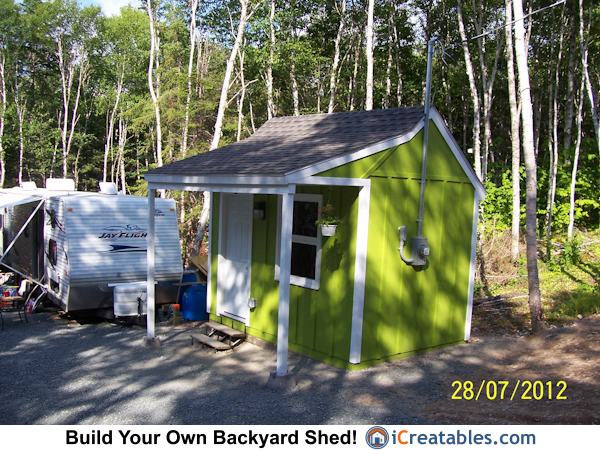 Right side view of 8x12 garden shed with porch. Note the electrical service pole on the shed.