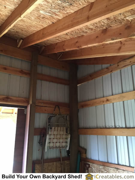 Interior roof and wall framing girt boards of horse barn.