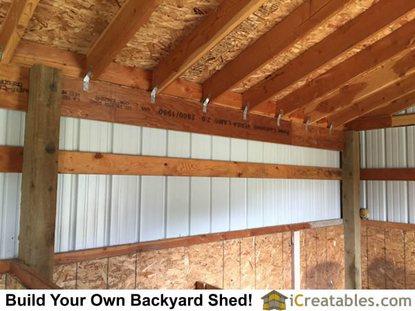 Interior of horse barn roof and girt boards with rear wall beam.