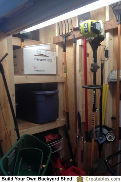 Equipment storage ideas using wall hooks for hanging tools