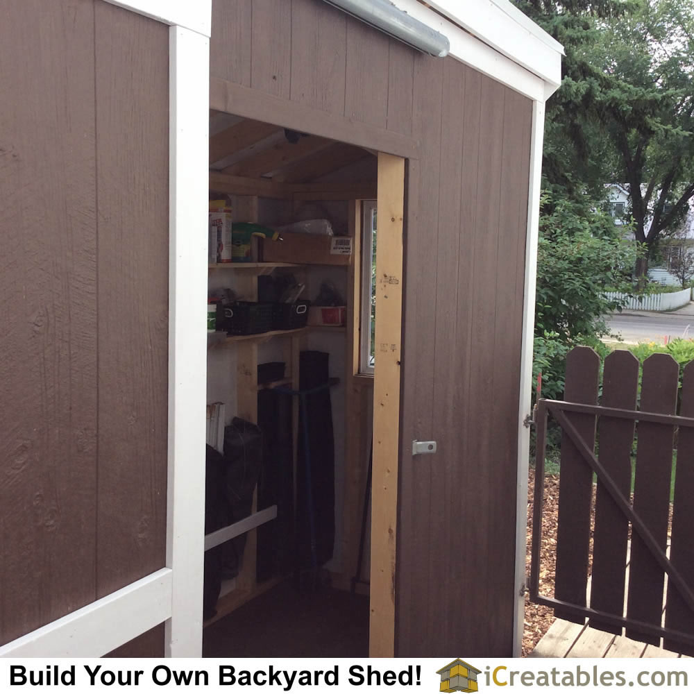 Side barn door on long wall with barn door hardware on pent roof shed plan.