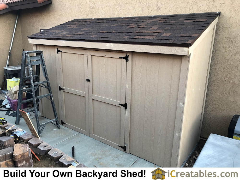 Lean to shed plans built with siding and doors installed.