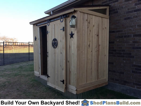 4x8 lean to shed plans built with hanging barn style door.