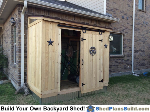 Completed 4x8 Lean lean to backyard storage shed with barn door. Plans by iCreatables.com