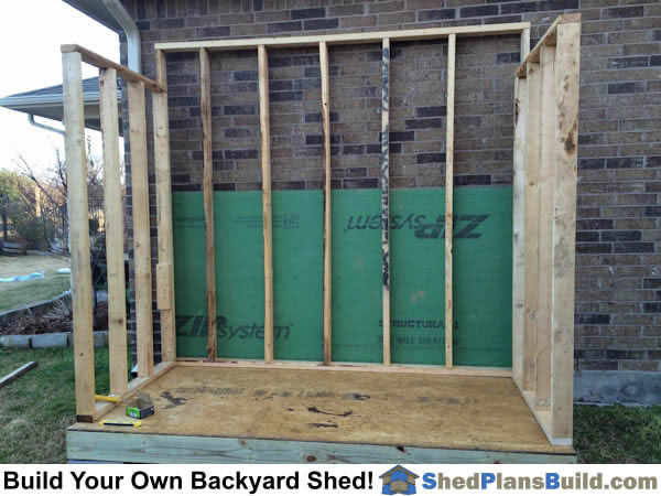 Rear and side walls framed for lean to shed construction.