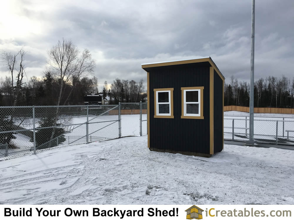 Completed lean to shed built to be used as ticket booth.