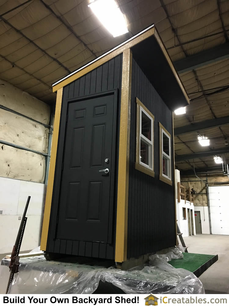 Entry door of 4x8 lean to shed. This shed uses a factory built pre-hung door so the shed can be easily secured.