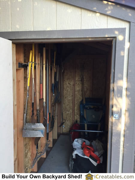 The shed is completed. Shed storage systems are hung on the shed walls to keep tools off the shed floor.