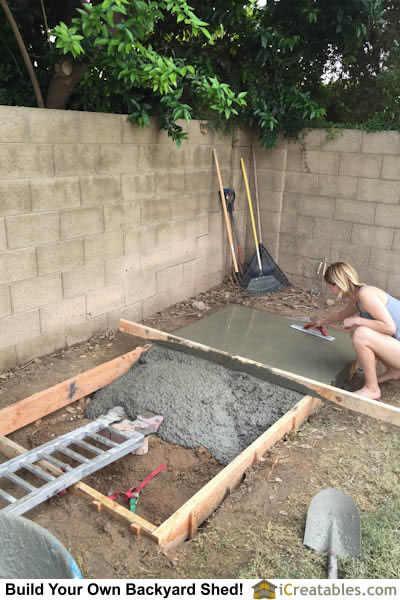 Screeding and magging the concrete slab for the storage shed floor.