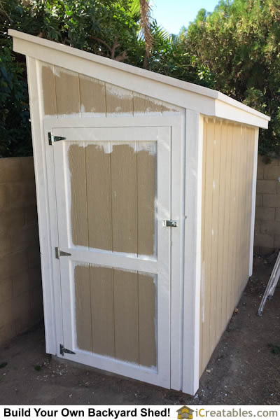 The trim on the shed is primed and painted white. The overlap is ok because the body paint will cover it on the shed walls.
