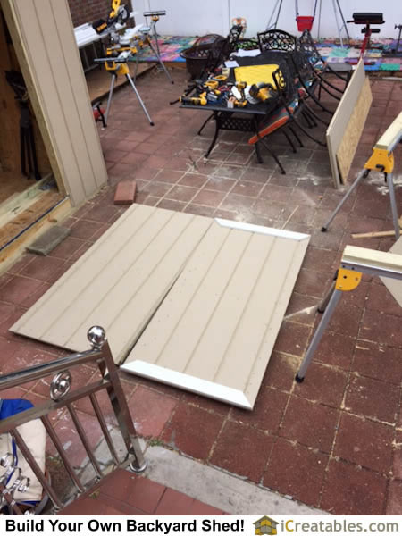 Installing trim on the exterior of the shed doors.