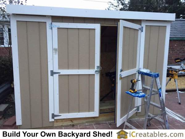 Swinging shed doors and locking hardware installed.